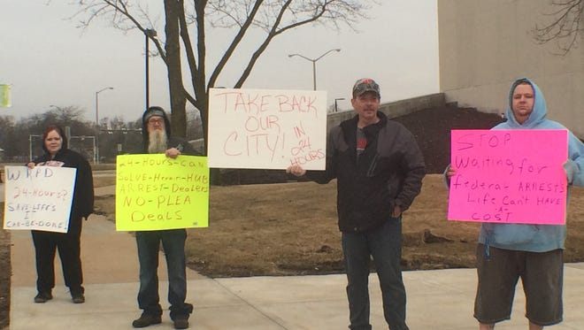 A small group of Wood County residents protested Monday morning on drugs in Wisconsin Rapids.