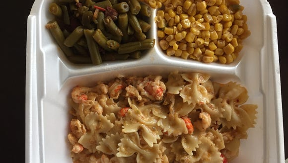 Crawfish mac and cheese, spicy green beans and corn