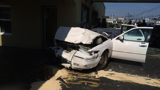 A car crashed into the Budget Inn on North Salisbury Boulevard March 16, 2016.