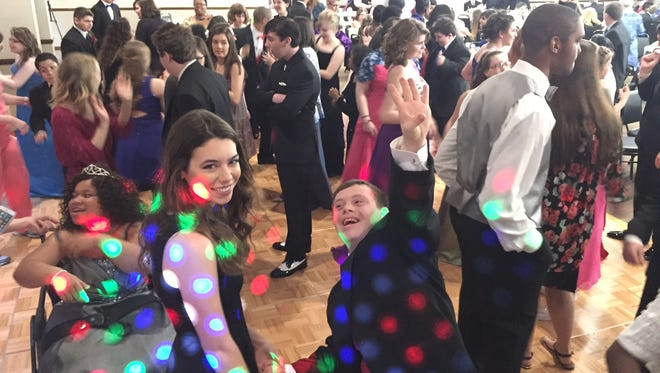 Students at Rutherford County Schools System's special-needs prom take to the dance floor Wednesday at Smyrna Town Centre.