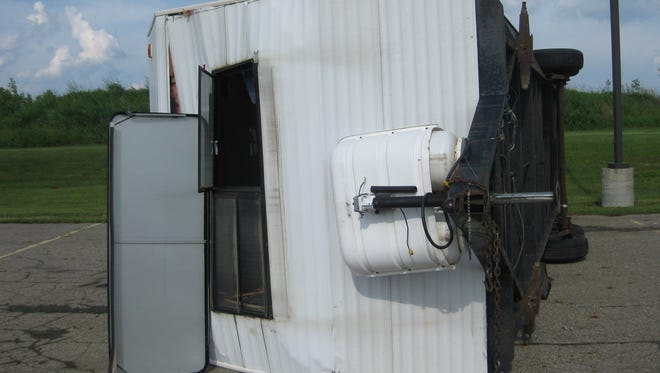 Sanilac County Firemen Association's mobile fire safety house was destroyed in a June 2014 wind storm that flipped the trailer. The association is raising money to purchase a new unit.