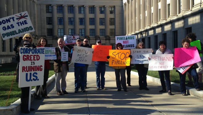 Activists opposed to the poposed New Jersey Natural Gas pipeline gathers outside the Bureau of Public Utilities in Trenton Friday.