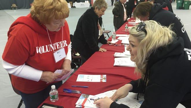 Volunteer Joan Weston of Poughkeepsie, left, helps Elissa Colgan of Hyde Park register for last year's American Heart Association Heart Walk.
