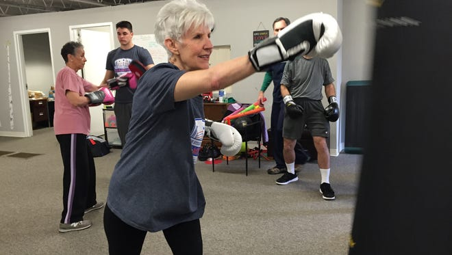 Margaret DeLucia, 71, takes a swing during a boxing class at Neuro Fitness Therapy Wednesday. DeLucia was diagnosed with Parkinson's disease four years and takes boxing to manage symptoms.