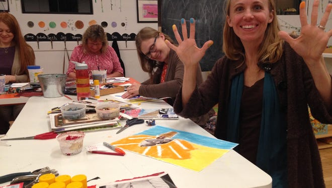 Kristi Ihde teaches and gets her hands dirty during a Reflections: Re-discovering YOU class.