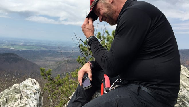 David Paulk sits on the edge  to enjoy the view at Calvary Rocks on Riprap Trail at Shenandoah National Park on Saturday, March 26, 2016.
