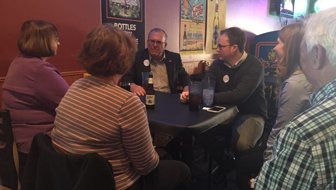 Businessman Mike Sherzan, a Democratic candidate for Iowa's 3rd Congressional District, talks with voters in Winterset.