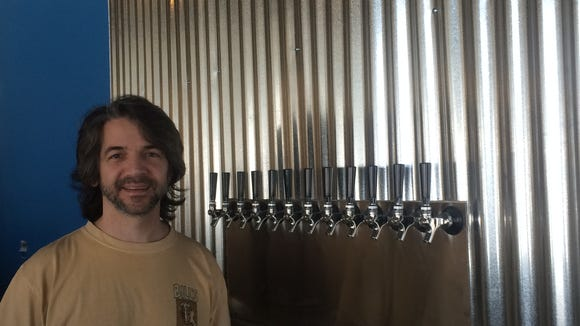 Anthony Abate stands before the 12 taps that will soon dispense Devil's Creek beer in Collingswood.