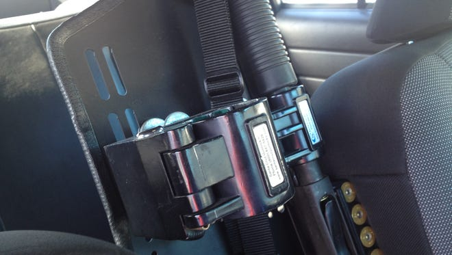 A suspect or suspects ripped a gun lock mechanism holding an AR-15 out of an unmarked police car belonging to the Salinas police chief.