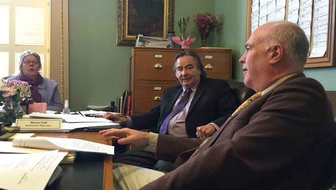 Sen. Joe Benning, R-Caledonia, right, debates state contract ethics with Sen. Anthony Pollina, P-Washington during a committee discussion on March 29, 2016.