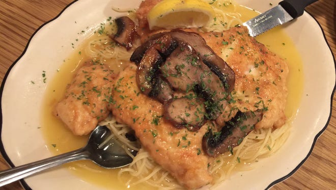Chicken Picatta, an egg-battered cutlet topped with a white wine, butter and lemon sauce and cremini mushrooms, is light and tender.
