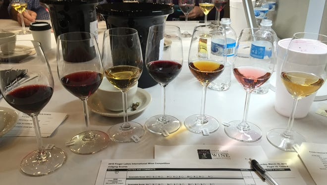 A mixed wine flight with ports, sherry, ice wine and dessert wine awaits judging at the Finger Lakes International Wine Competition in March 2016.