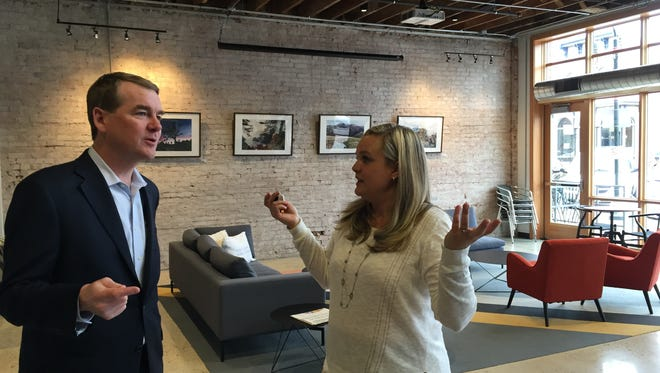 Colorado Sen. Michael Bennet talks to Galvanize campus director Charisse Bowen Tuesday, March 30 2016 in Fort Collins.