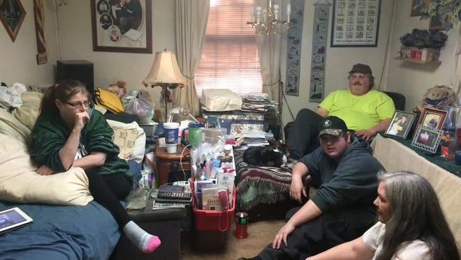 Dani Preston, left, listens as her family talks about her health in her living room Saturday, March 26, 2016. Also pictured are Jamie Preston, seated, Dakota Preston and Ronda Bannister.