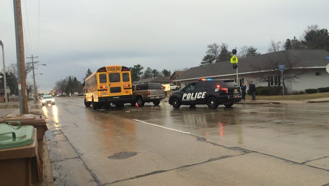 A car and school bus were involved in a crash on Church Street early Wednesday morning.