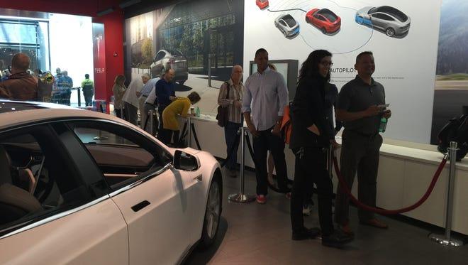 People line up at Scottsdale Fashion Square to make a deposit on Tesla Model 3