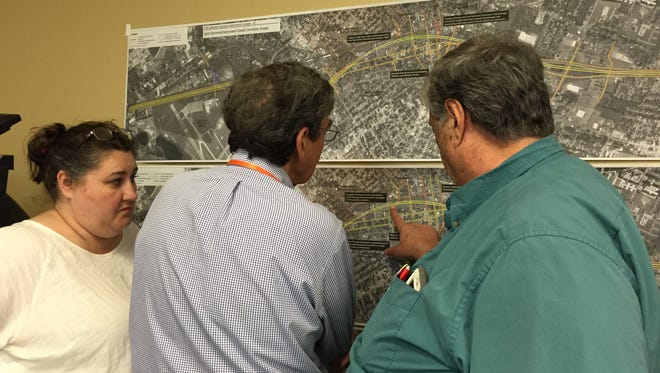 Members of the I-49 Lafayette Connector Community Working Group discuss the project March 31, 2016.