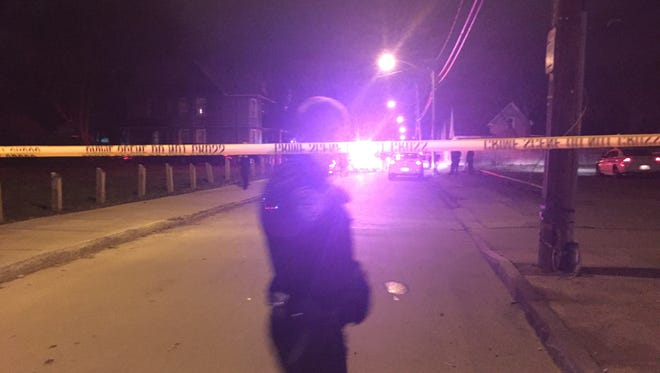 Rochester police on scene at an officer-involved shooting on Immel Street late at night on April 1, 2016.