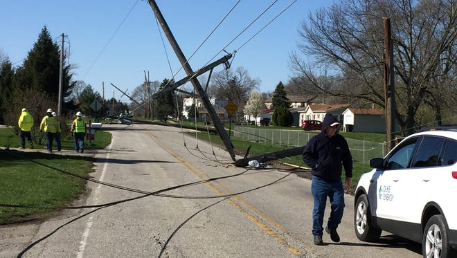 Crews assess damage Sunday on Old Romney Road as high winds downed several power lines across Lafayette Saturday.