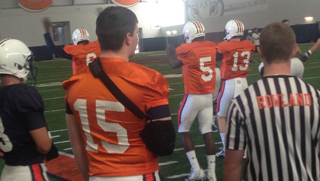 Auburn backup quarterback Tyler Queen (15) with his right arm in a sling during Auburn's 12th spring practice of the season on April 5, 2016.