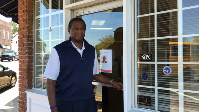 Allstate Insurance agent Cornell Sweeney stands outside his office in downtown Simpsonville.