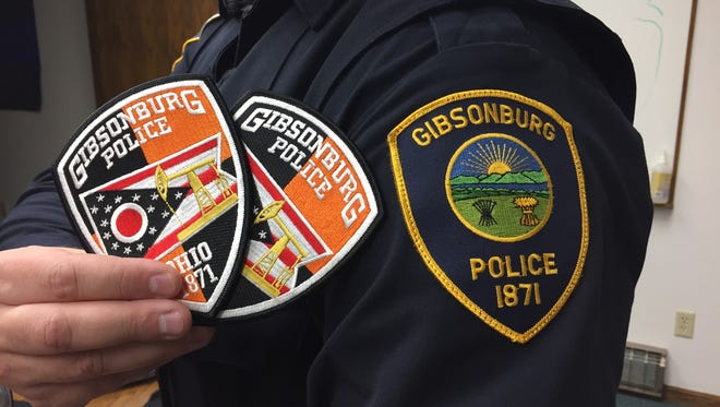 Out with the old, in with the new as Gibsonburg unveils news police patch created by officer Mike Senyo.