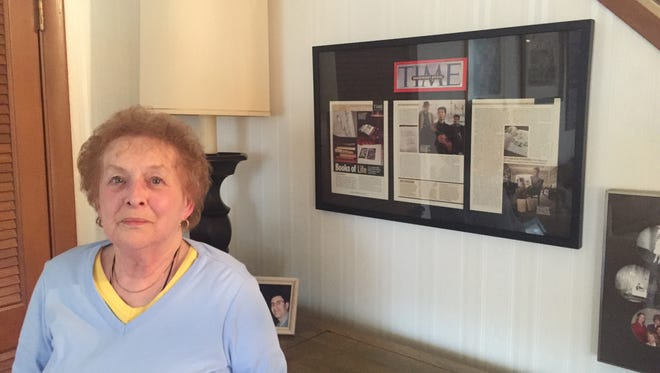 Joyce Field, an expert on Jewish genealogy, stands in front of a Time magazine feature on her published several years ago.Field will be a featured speaker Sunday during The Holocaust Remembrance Conference.