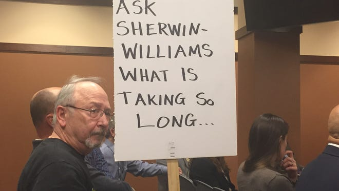Kirkwood Lakeside resident Ed Kelleher protests delays in dredging the lake as part a Superfund cleanup site from contamination by paint company  Sherwin Williams