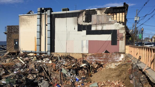 The fire at 43 West Front Street in Keyport left this rubble pile and damaged an adjacent structure,
