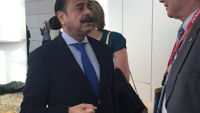 Shahid Khan, owner of Flex-N-Gate and the Jacksonville Jaguars, talks to attendees of SAE World Congress on Tuesday, April 12 2016 at Cobo Center.