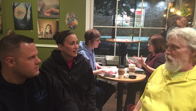 John Richardson of Southampton  thanks Mount Holly police officers Greg Walters and Jana Loehr for saving his life after he suffered a heart  problem that caused him to crash his car in February in Mount Holly. They are chatting at a Daily Grind coffee reception in Mount Holly after the officers were recognized Monday night at the Mount Holly Council meeting.