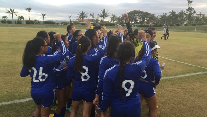 In this file photo, the Notre Dame Royals celebrate a win over the Simon Sanchez Sharks in the IIAAG Girls' Soccer League.