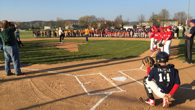 Treyton Smith throws a ceremonial first pitch during York City Little League's opening day Friday at Rotary Field at Allen Park.