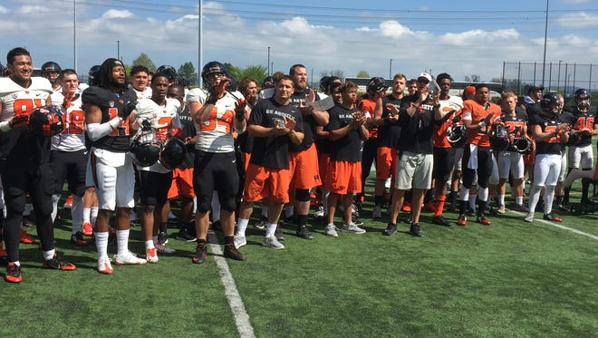 Oregon State players and coaches singe the school fight song after last Saturday's scrimmage at Hillsboro Stadium.