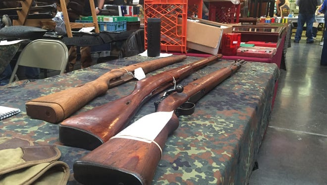 Firearms are for sale at a gun show in Newark on Jan. 9. Congressional candidates offered their views on gun-owner rights.