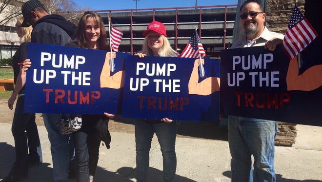 """Debbie Maggiacomo, 51, of Salt Point, Joyce Circlio, 53, and Randy Circlio, 56, of LaGrangeville made """"Pump Up the Trump"""" signs to hold at Republican presidential candidate Donald Trump's rally at the Mid-Hudson Civic Center in the City of Poughkeepsie Sunday."""