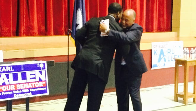 Former NBA player and Greenville native Shammond Williams, left, hugs state Sen. Karl Allen of Greenville during Allen's re-election kickoff at the Phyllis Wheatley Community Center Monday evening.