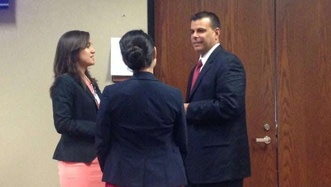 Finalist Rob Hernandez talks to Chief Human Resources Officer Melissa Carrillo and Deputy Human Resources Officer  Michelle Cochrane after his interview with Commissioners Court.