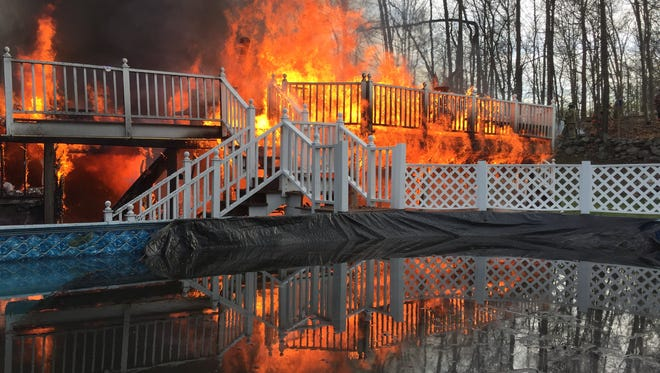 Mahopac firefighters arrived to find a fully engulfed house fire on Mega Lane in Mahopac April 18, 2016. Several neighboring departments assisted at the scene. There were no injuries reported and the house was totally destroyed.