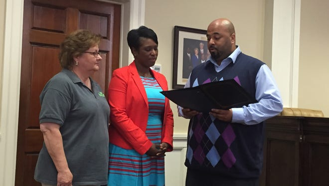 City Clerk Kermas Eaton, right, presents members of West Point Christian Center and Early Encounters with a proclamation during Tuesday's meeting of Hattiesburg City Council.