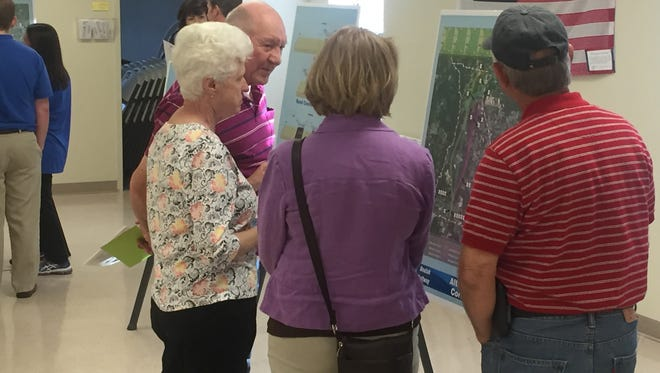 Citizens review plans for a proposed highway project to connect Nine Mile Road and U.S. 29.