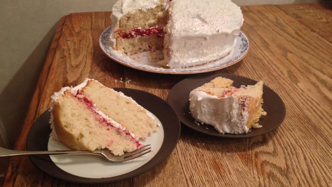 An old-fashioned white cake is updated with local ingredients and a filling of raspberry jam.