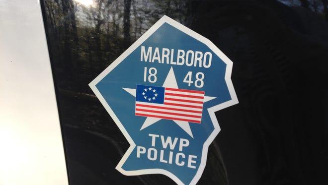 Three Marlboro police officers rescued an elderly man from a burning farmhouse.