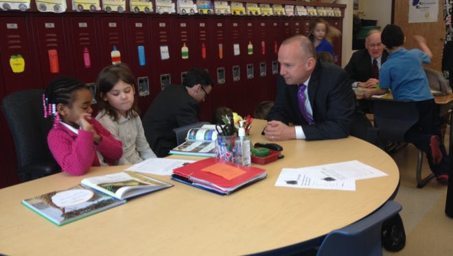Gov. Jack Markell talks with students in a first-grade English class at Lancashire Elementary School on March 10, 2014.