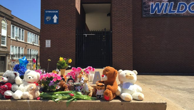 A memorial at Howard High School in Wilmington included notes from local community members and numbers to call should students seek help.