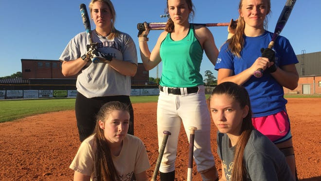 Milton softball players (back row, left to right) Krystal Cahill, Megan Robertson, Kelsey Hodges, (front, Lto R) Taylor Forte and Paige Brown are pumped for another shot at Niceville in the Region 1-7A Semifinals.