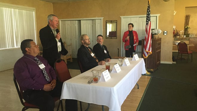 Lincoln County sheriff candidates, from left; Rudy Saiz, Bill Heineken (with microphone), Bill Butts and current Sheriff Robert Shepperd.