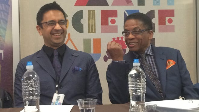 Jazz pianists Vijay Iyer, left, and Herbie Hancock share a laugh before unveiling of new music, math and science curriculum at the U.S. Department of Education in Washington on Tuesday.