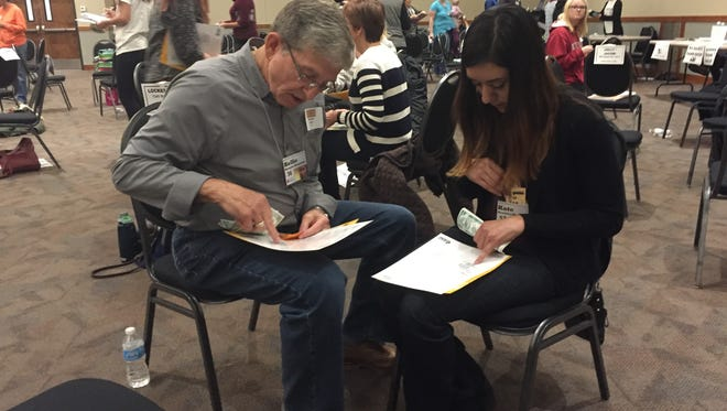 More than 100 people participated in an April 26, 2016, community-wide poverty simulation, co-hosted by the Coloradoan and United Way of Larimer County and sponsored by Columbine Health Systems and Texas Roadhouse. Attendees pledged $1,095 to fighting poverty through United Way of Larimer County, more than doubling a $500 fundraising goal. More than 100 people participated in the simulation.