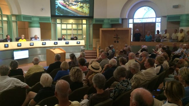 Opponents to a proposed commercial project in La Quinta filled the council chamber at City Hall Tuesday night for a Planning Commission meeting where the developer announced he was withdrawing his application.